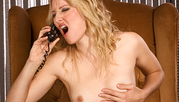 young housewife has phonesex, naked on the couch